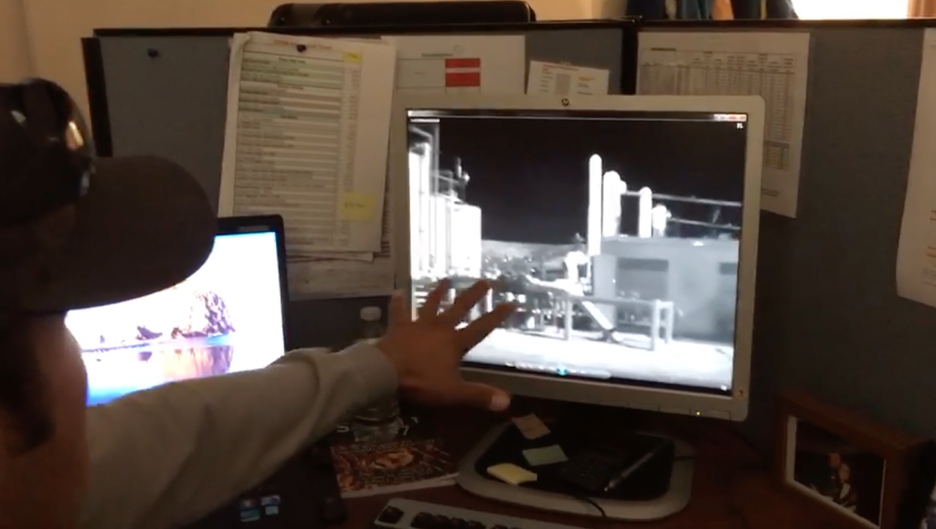 Caesar Deiaz, an inspector for Jonah Energy, describes the infrared camera footage from a recent site inspection. Photo: Amber Reimondo